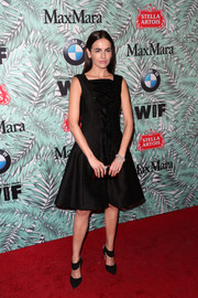 Camilla Belle was sweet and stylish in a lace-up LBD by ADEAM at the Women in Film pre-Oscar cocktail party.