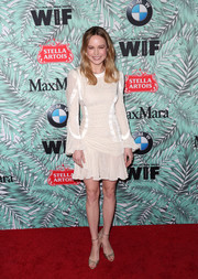 Brie Larson styled her frock with gold peep-toe heels by Schutz.