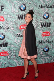 Jurnee Smollett-Bell arrived for the Women in Film pre-Oscar cocktail party wearing a black cape over a pink dress.