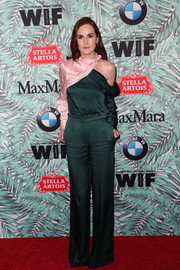 Michelle Dockery worked a modern vibe in a forest-green and pink cutout blouse by Monse at the Women in Film pre-Oscar cocktail party.