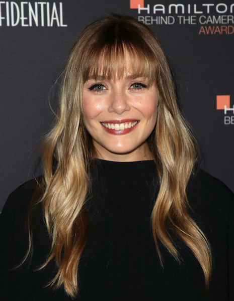 Elizabeth Olsen looked lovely with her long waves and wispy bangs at the 2018 Hamilton Behind the Camera Awards.