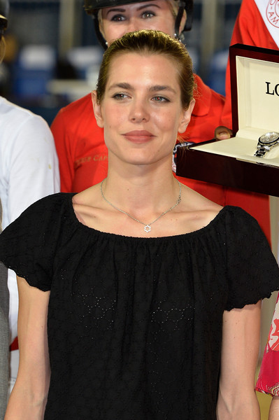 Charlotte Casiraghi accessorized with a delicate star pendant at the Longines Global Champions Tour of Monaco.