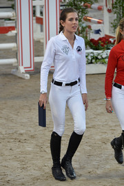 Charlotte Casiraghi completed her sporty outfit with a pair of black riding boots.