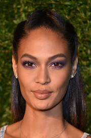 Joan Smalls went for a vibrant beauty look with lots of purple eyeshadow.