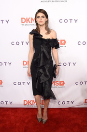 Alexandra Daddario looked positively alluring in a black off-one-shoulder ruffle dress by Christian Siriano at the DKMS Big Love Gala.