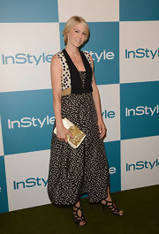 You never really know what your going to get when Jenna Elfman steps on the red carpet. For the InStyle event, the actress went for an eclectic styling of a print ankle-length dress, beaded handbag and strappy heels.
