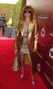 Linda Ramone went for total shimmer, teaming her coat with silver and gold knee-high boots.