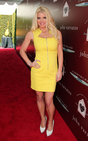 Jessica Simpson flaunted her slimmed-down figure in a bright yellow zipper-front mini during the John Varvatos Stuart House Benefit.