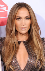 Jennifer Lopez is known for her bronzed, sun-kissed glow. She attended the Latin Grammy Awards rockin' her signature look, which was the perfect complement to her honey-blond tresses.
