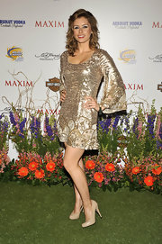 Brianna sparkled in a gold-sequined dress with a simple pair of nude leather pumps.