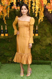 Freida Pinto cut an elegant figure in a marigold Cinq à Sept dress with Juliet sleeves  and a ruffled hem at the 2018 Veuve Clicquot Polo Classic.
