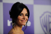 Courtney Cox showed off her dangling gemstone earrings at the 'InStyle' Golden Globe party.