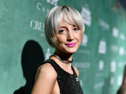 Andrea Riseborough attended the Women in Film pre-Oscar party wearing her hair in a bowl cut.