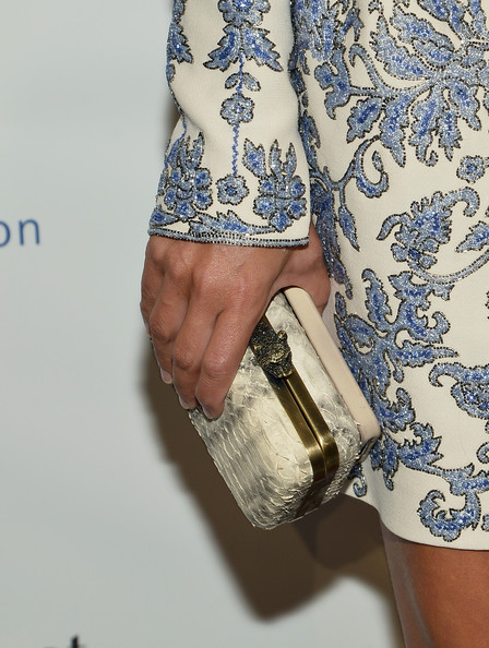 Charlotte Ronson completed her ultra-sophisticated ensemble with a white snakeskin hard-case clutch when she attended the Brazil Foundation NYC Gala.