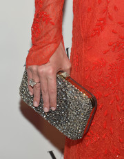 Nicky Hilton was the picture of glamour at the Brazil Foundation NYC Gala with her gemstone-studded clutch and lace dress combo.