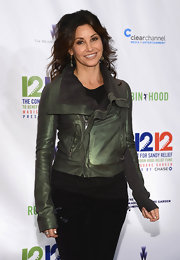 Gina Gershon looked fierce in a metallic-green leather moto jacket at the 12-12-12 concert.