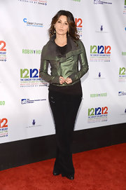 Gina Gershon opted for a casual, edgy look with a pair of black corduroys and a metallic moto jacket when she attended the 12-12-12 concert.