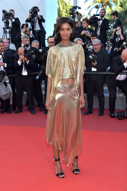 Liya Kebede styled her look with black satin ankle-cuff sandals.