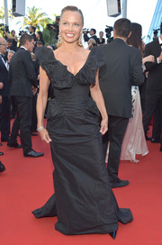 Pamela Anderson donned a black Vivienne Westwood Couture gown with a plunging ruffled neckline for the Cannes Film Festival screening of '120 Beats Per Minute.'
