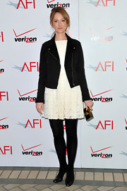 Judy Greer bundled up in black tights and patent leather pumps.