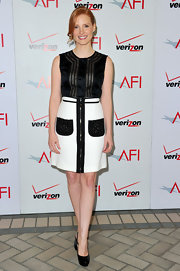 Jessica Chastain paired her black and white ensemble with classic black patent leather slingbacks.