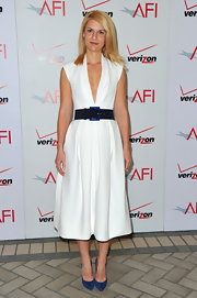 Claire Danes accessorized her structured white dress with a wide belt and blue suede stilettos.