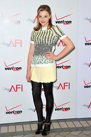 Chloe Moretz wore a pale yellow tee with a matching pleated skirt at the AFI Awards.