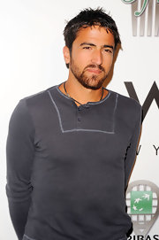 Janko Tipsarevic dressed casually in a gray henley top at the Taste of Tennis event.