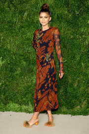 Zendaya Coleman looked seriously stylish at the CFDA/Vogue Fashion Fund Awards wearing this Thakoon print dress in autumnal hues.