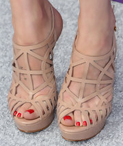 Dakota Johnson's nude strappy sandals were a cool choice for the 12th Annual Chrysalis Butterfly Ball.