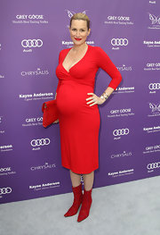 Alice Evans chose a fitted maternity dress in a bright candy apple red hue for her look at the 12th Annual Chrysalis Butterfly Ball.
