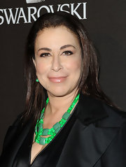 """Nip Tuck"" actress Roma Maffia showed off a bright green stone necklace at the Costume Designer Guild Awards. The brightly toned jewels gave her all black look some added interest."