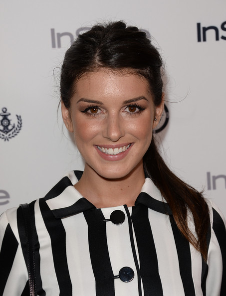 Shenae Grimes stuck to a casual ponytail to dress down her look at InStyle's Summer Soiree.