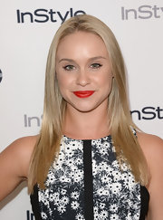 Becca showed off her pretty smile with a red lip that had just a slight coral undertone.