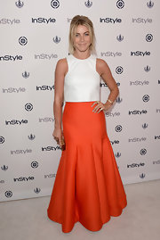 Julianne added contrast to her look by pairing her bold tangerine skirt with a crisp white top.