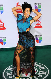 Alejandra Guzman holds nothing back! For the Latin Grammys the bold starlet stepped out in a unique gown.