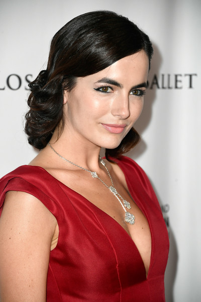 Camilla Belle complemented her deep-V dress with a gorgeous diamond chandelier necklace by Lorraine Schwartz.