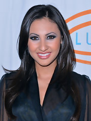 Francia Raisa emphasized her bright brown eyes with metallic sliver shadow and lots of volumizing mascara.