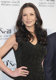 Catherine Zeta Jones arrived at the 12th Annual Monte Cristo Awards wearing her luxurious mane in loose flowing curls.