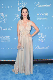Katy Perry got all frilled up in a petal-appliqued champagne gown by Marchesa for the UNICEF Snowflake Ball.