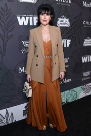 Rumer Willis layered a beige blazer over an ochre gown for the Women in Film Oscar nominees party.
