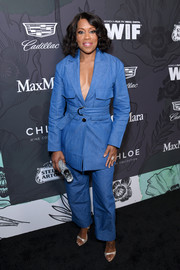 Regina King looked cool in a belted denim pantsuit by Arias at the Women in Film Oscar nominees party.