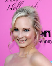 Candise Accola showed off her messy updo while attending the Young Hollywood Awards. Her blue eyeshadow underneath her eye really stood out when paired with her blonde locks.