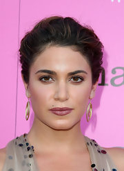 Nikki Reed showed off her fabulous gold dangling earrings by pinning her hair up in a classic loose bun.