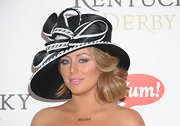 Aubrey had fun at the Kentucky Derby in a large black and white straw hat with a jeweled detail.