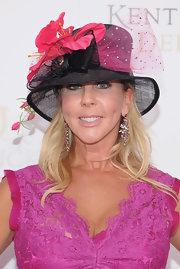 Vicki Gunlavson's hat was perfect for the Derby! Between the pink tulle bow and hibiscus flower detailing she had quite the party on her head.