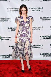 Coco Rocha's Derby style looked fun and flirty with this purple floral frock.
