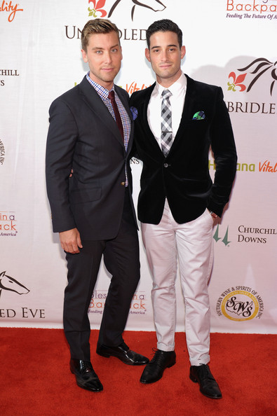 Michael Turchin paired a black velvet blazer with white pants for a dapper look during the Unbridled Eve Gala.