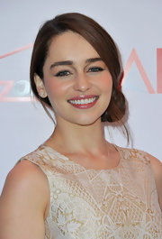 Emilia Clarke wrapped her locks into an elegant low bun for 2013 AFI Awards.