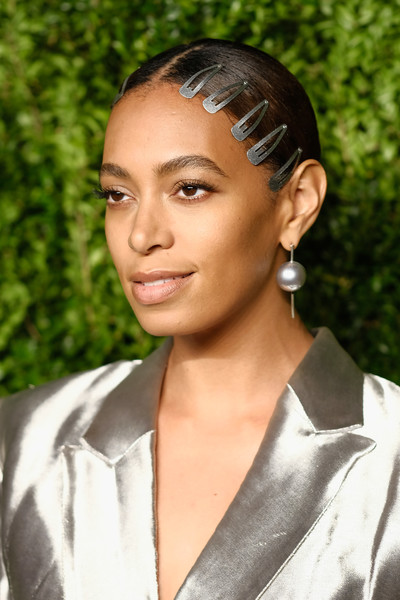 Solange Knowles showed off her one-of-a-kind style with this slicked-down, center-parted bun adorned with multiple barrettes.
